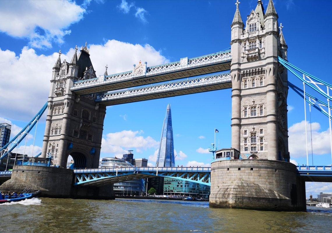 shard through tower bridge by boat